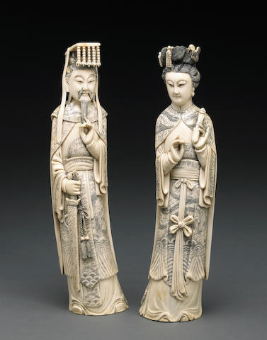 A pair of tinted ivory emperor and empress figures 20th Century
