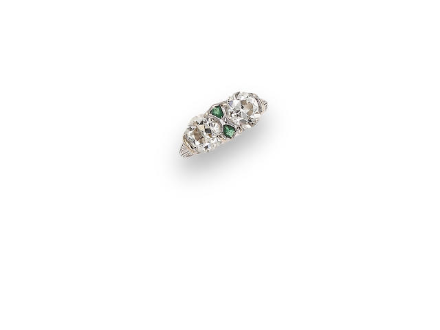 An art deco diamond and emerald two-stone ring, circa 1925