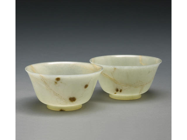 A pair of small nephrite bowls with gilt decoration Late Qing Dynasty
