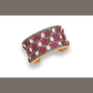 A ruby and diamond bangle bracelet