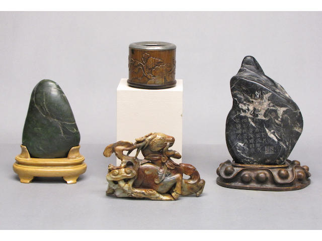 A group of three hardstone decorations and a bamboo water coupe
