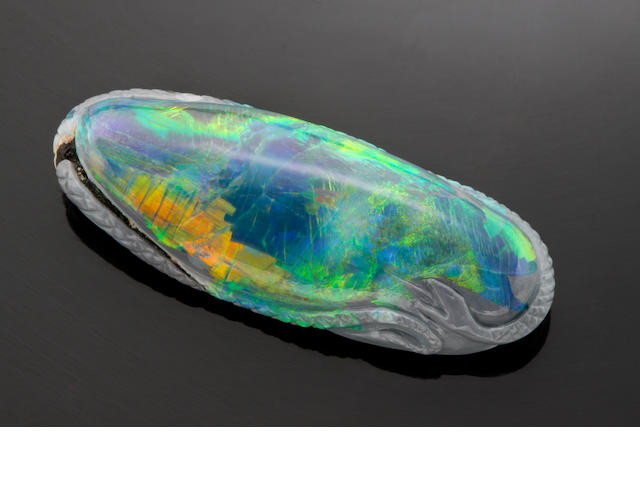 "Published Piece: Historic Carved Black Opal together with the book ""The Story of the Gems"""