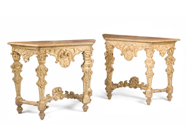 A fine pair of Italian Baroque giltwood and faux marble console tables  probably Venetian late 17th/early 18th century