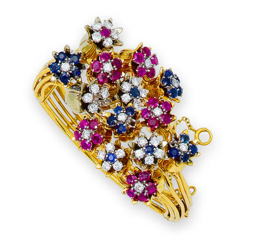 A ruby, sapphire and diamond bangle bracelet