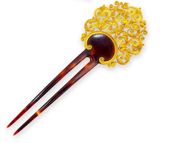 An antique tortoise shell and fourteen karat gold hair ornament,