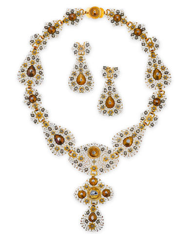An antique diamond, silver and fourteen gold necklace and earclips,
