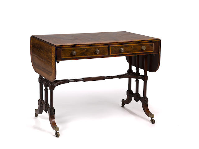 A Regency mahogany and rosewood crossbanded sofa table<br>circa 1815