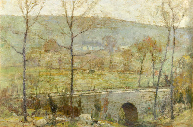 Chauncey Foster Ryder (American, 1868-1949) An autumn landscape with a bridge over a stream 20 x 30in