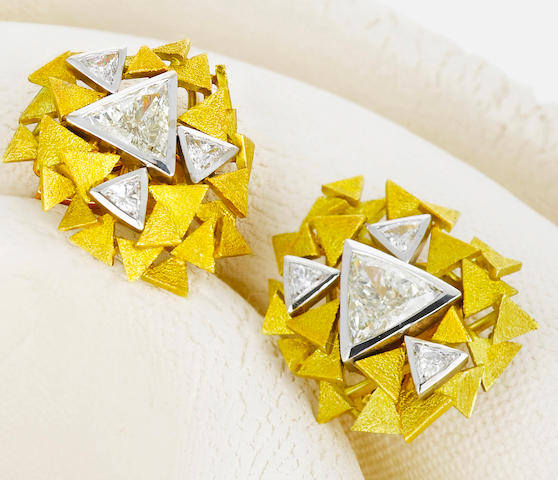 A pair of diamond and eighteen karat bicolor gold earclips, Andrew Grima,