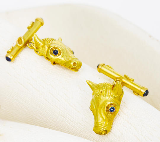 A pair of eighteen karat gold and sapphire cufflinks, mounted by Andrew Grima