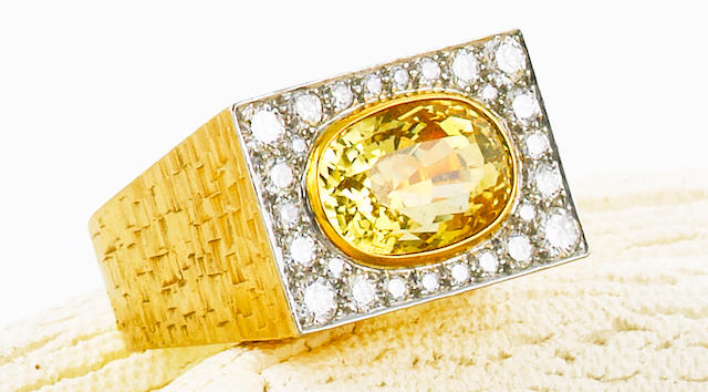 A yellow sapphire and diamond ring, Andrew Grima,