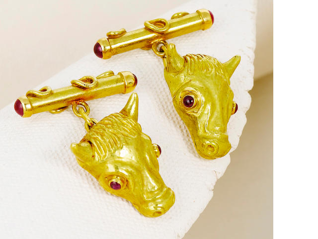 A pair of eighteen karat gold and ruby cufflinks, mounted by Andrew Grima