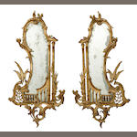 A pair of George III style paint decorated mirrors<br>early 20th century