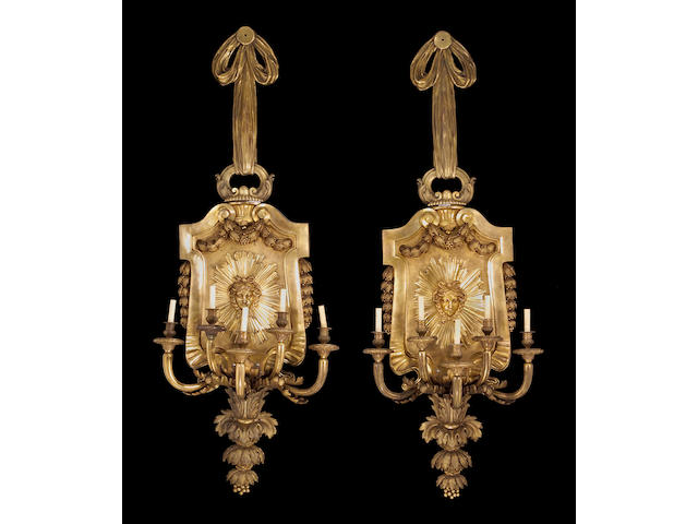 A pair of fine and monumental Louis XVI style bronze five light bras de lumière<br>early 20th century