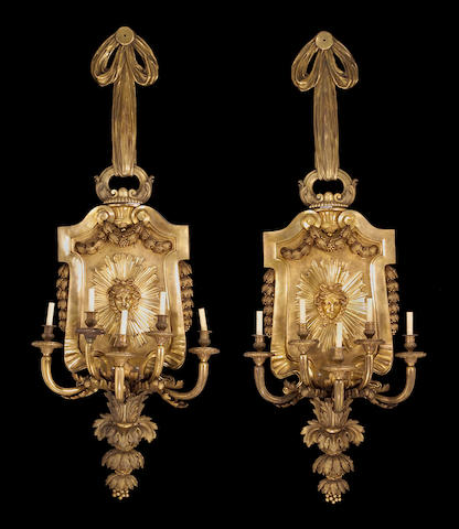 A pair of fine and monumental Louis XVI style bronze five light bras de lumière early 20th century