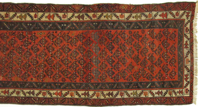 A Kurdish runner size approximately 2ft. 11in. x 10ft. 9in.