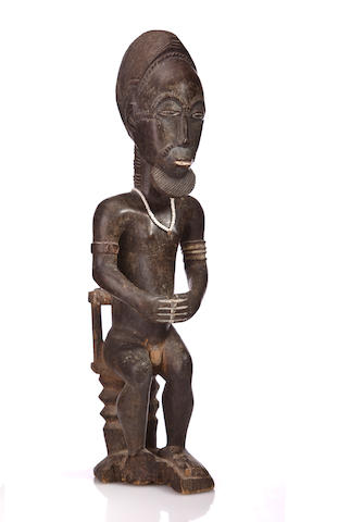 A Baule male seated figure, Ivory Coast height 22 in