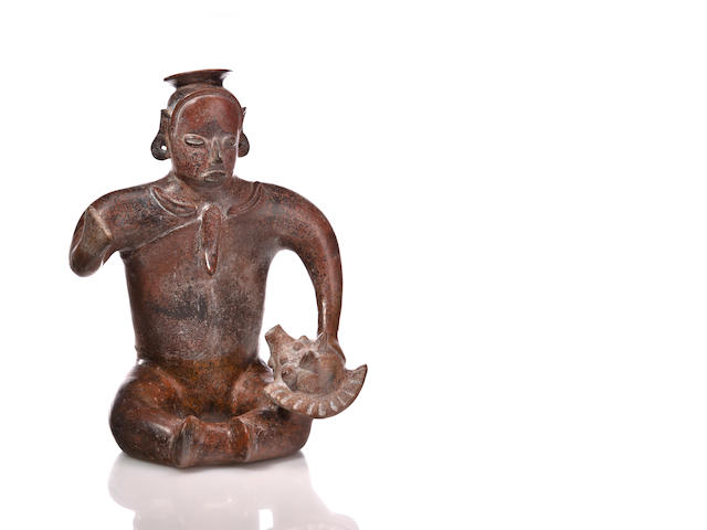 Colima Seated Figure with Shell,<br>Protoclassic, ca. 100 B.C. - A.D. 250