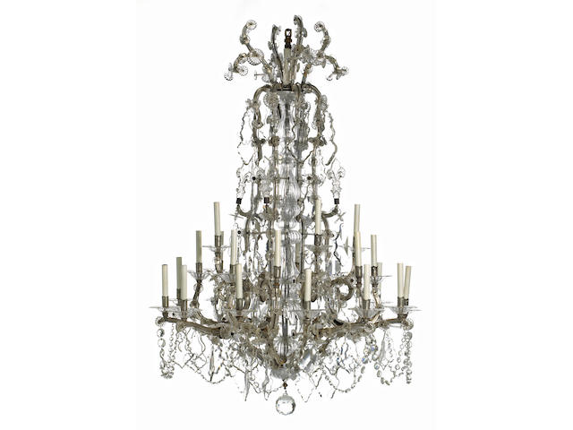 A Continental Rococo style silvered metal and glass twenty-four light chandelier 20th century