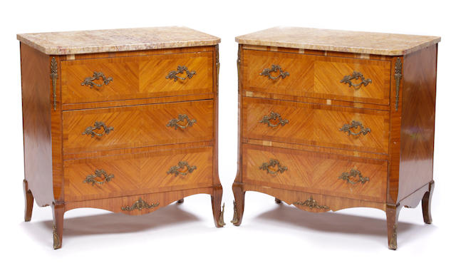 A pair of Louis XV/XVI transitional style inlaid walnut commodes
