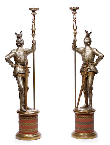 A pair of gilt and silvered metal figural floor lamps modeled as knights