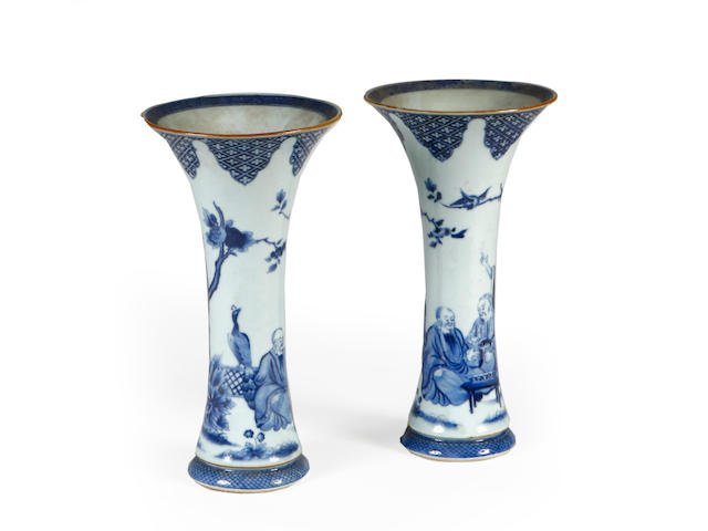 A pair of Chinese blue and white Gu-form vases