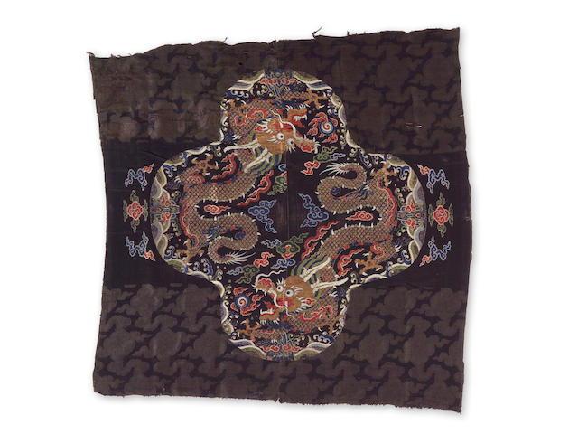 A black ground silk brocade fragment with gilt and polychrome dragon reserve Early Qing Dynasty