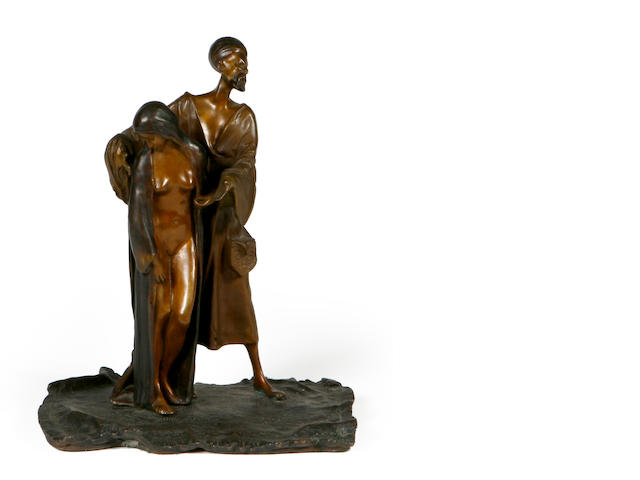 A patinated bronze figural group of a slave trader and nude