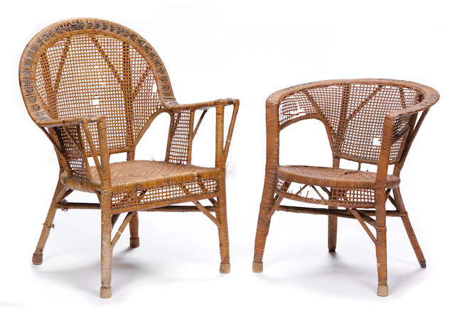 A group of four wicker armchairs