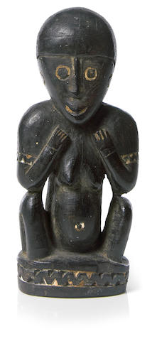 A Trobriand Islands figure, Massim area, Papua New Guinea height 7 3/4in