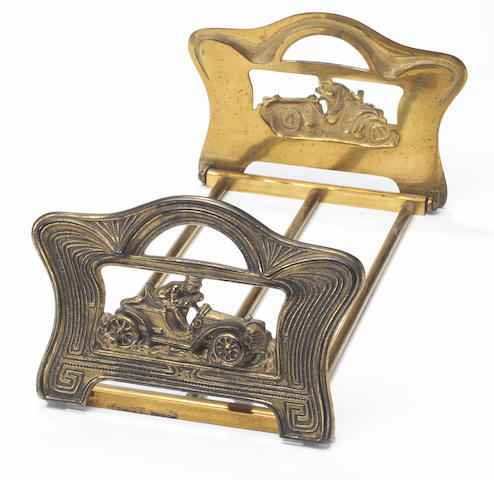 An adjustable brass sliding bookrack, British, circa 1910,