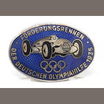 An enamelled Auto Union badge, 1935,