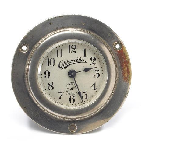 An Oldsmobile dashboard mounting clock,
