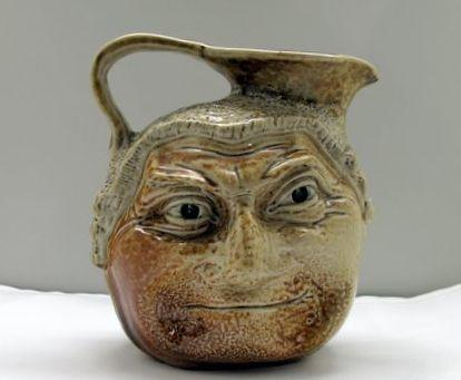 A fine and early Martin Brothers Barrister Face Jug, circa 1900,