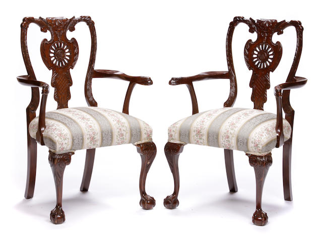 A set of four George III style carved hardwood armchairs