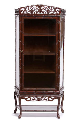 A Chinese carved hardwood display cabinet on stand