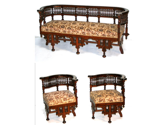 A Moorish style inlaid three piece salon suite