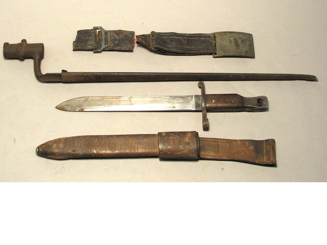 A group of two edged weapons and a U.S. Pattern 1851 belt buckle