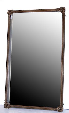 A Rococo style gilt composition mirror