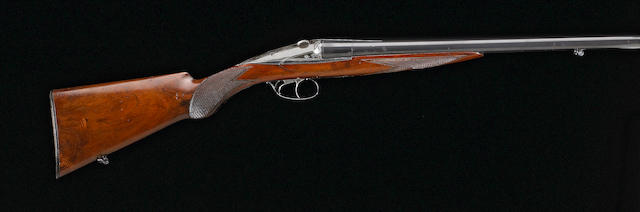 A 20 gauge Darne side-by-side shotgun