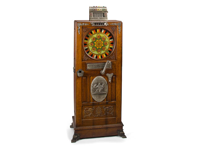 "A rare upright coin-operated Roulette consul, ""The Judge"",  circa 1899, by the Mills Manufacturing Company, USA, supplied by Albert Pick & Company, Chicago,"