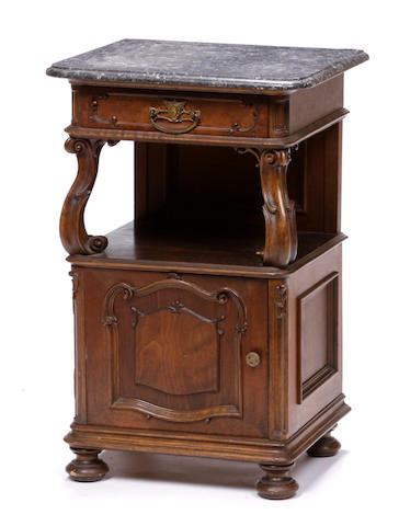 A Continental Rococo style walnut marble topped bedside cupboard