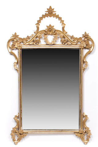 An Italian Rococo style carved giltwood mirror