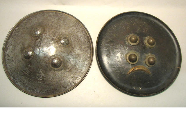 A lot of two Indian shields