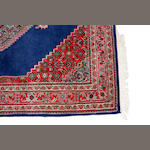 An Indian carpet size approximately 4ft. x 6ft.