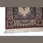 A Chinese carpet size approximately 2ft. 6in. x 12ft.