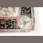 An Indian carpet size approximately 9ft. 11in. x 14ft.