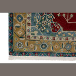 A Tibetan carpet size approximately 8ft. x 11ft.