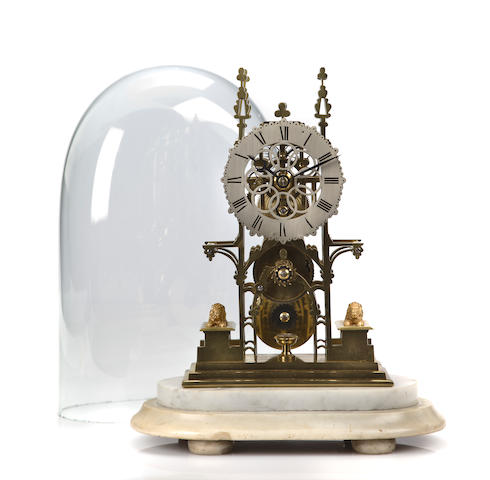 A skeleton clock with key, pendulum and glass dome