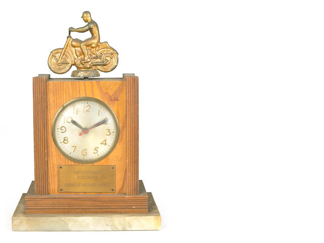 A Johnson Motors Electric Mantle Clock award,